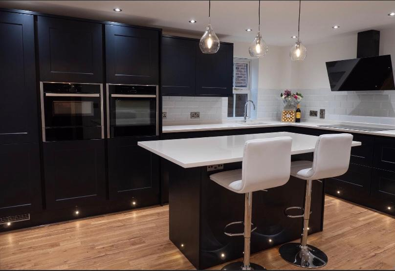 stunning new kitchen refit with glossy black cupboards